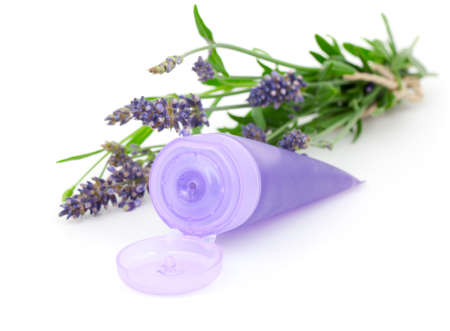 Lavender soothing cream tube and lavender flower, isolated on white background photo