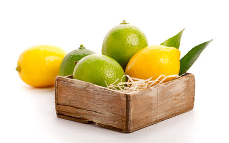 food package: yellow and green lemon over white background. Stock Photo