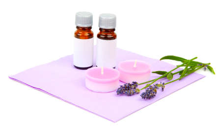 Lavender oil, candle and lavender flower, isolated on white background photo