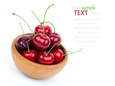 sour cherry: Cherry in wooden bowl isolated on white background Stock Photo