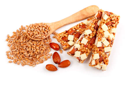 Protein bars with nuts, isolated on white background    muesli bar snack with nuts and wheat grain photo
