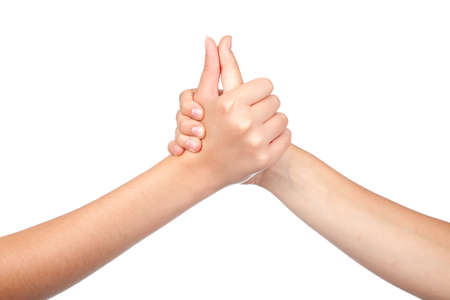 two hands teenager, holds his thumb up. Teamwork. Symbol for success. isolated on white background photo