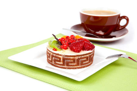Low-calorie fruit cake with cup caffee, on white background photo