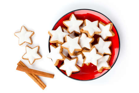 star shaped cinnamon biscuit on red plate, on white background photo