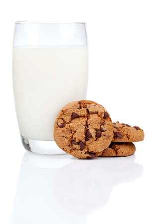 Glass of milk and cookies isolated on white photo
