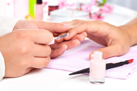 manicurist: Manicure  Care of fingers of hands, cleaning, covering a varnish of nails  Stock Photo