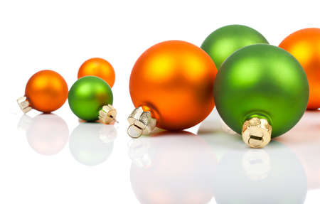 christmas sphere: Multi-colored Christmas ornaments - orange and  green, on a white background with copy space Stock Photo