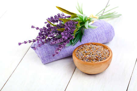 lavanda: dry Lavender herbs, and flowers on the serviette, on white wooden background