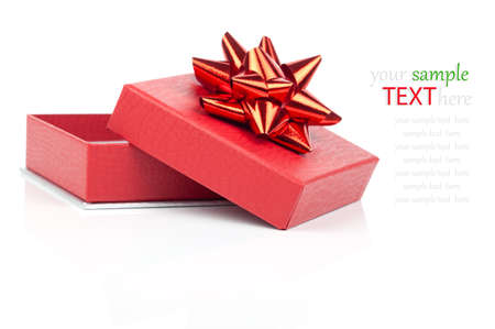 Single red gift box with red ribbon, on white background. photo