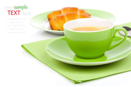 Fresh coffee and tasty croissant, on the white background photo