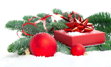 red Christmas ball with pine branch, gift and snow, isolated on white background photo