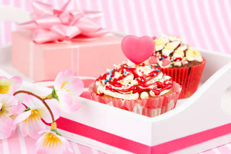 Valentine cupcake with a heart candle, isolated on a white background Stock Photo - 16846502