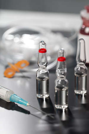 medical ampoule and syringe. Vials of medications. photo
