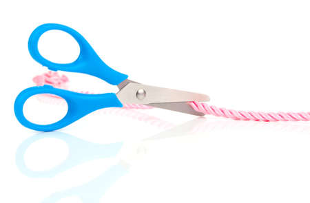 scissors cutting the rope, isolated on white background photo