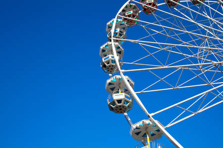 Attraction is the wheel of review on background blue sky photo