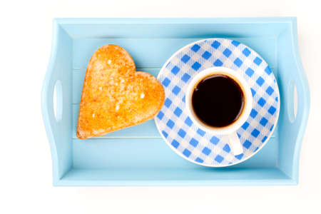 cookies in the shape of heart with coffee cup, in a tray for breakfast  isolated on white background  photo