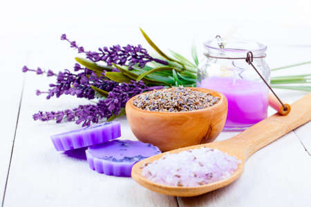 rosemary flower: dry Lavender herbs, bath salt and candle, on white wooden table Stock Photo