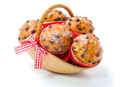 Muffins in a basket isolated on white background photo