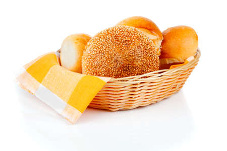 fresh baked buns in a basket on white background Stock Photo - 17756065