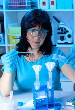female scientist make maxiprep in the lab photo