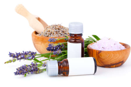 massage oil: Lavender oil, lavender bath salt on white background Stock Photo