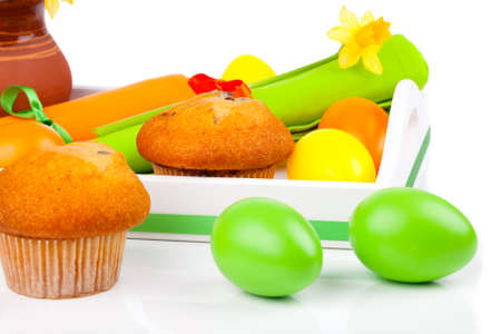Muffin in Breakfast tray with Easter Eggs, isolated on white background