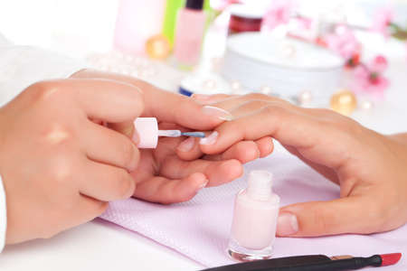 manicurist: Manicure. Care of fingers of hands, cleaning, covering a varnish of nails.