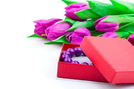armlet: bangles in the gift box and tulips on isolated background