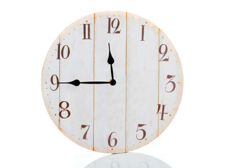 Old wall clock isolated on white photo