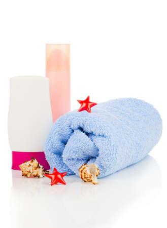 bathtowel: sunscreen cream and bath towel isolated on white