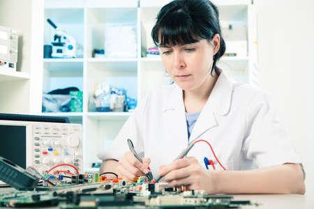 debugging: Girl debugging an electronic precision device