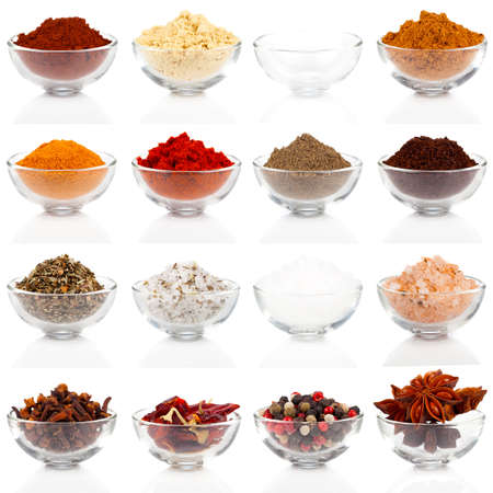 indian mustard: Variety of different spices in glass bowls for seasoning, isolated on white background