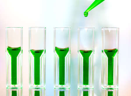 science tips: Spectrophotometer quvettes on a reflective surface, copy space