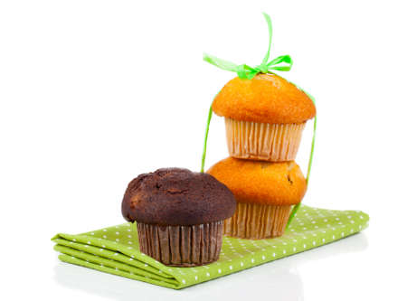 sweet muffins on white background photo