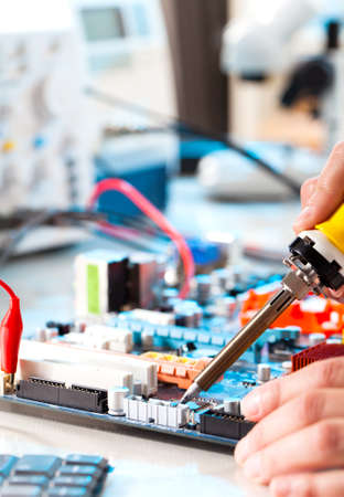 repaired: Repaired by soldering a PC board Stock Photo