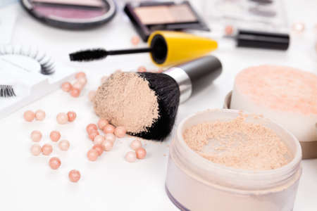 Powder with a brush on a white background and other cosmetics Stock Photo - 19327923