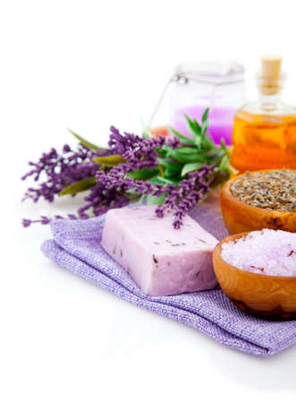 aromatherapy oils: Spa treatment. Lavender bath salt, soap, oil and lavender flower, isolated on white background