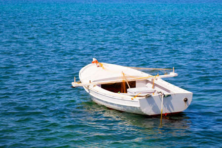 lifeboat: Boat in water. Old wooden boat