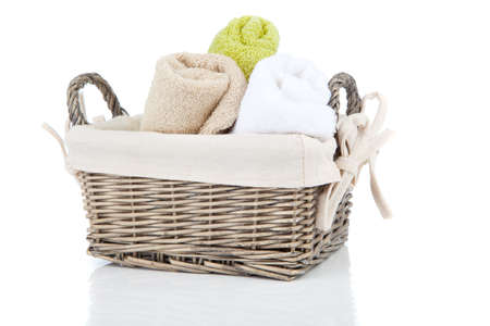 laundry basket: Colorful towels in basket isolated on white