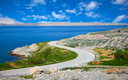 dalmatian part of the Adriatic coast and rocky beach, with blue sky  in Pag in Croatia  photo