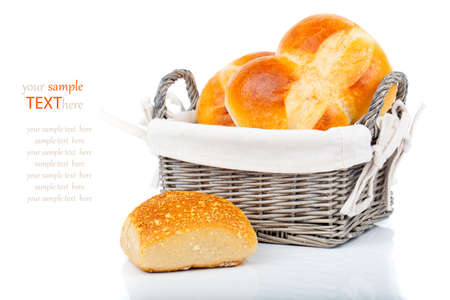 Baked bread bun in basket. isolated on white photo
