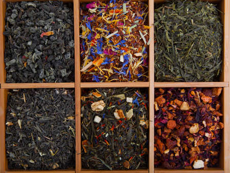 assortment of dry tea in wooden box photo