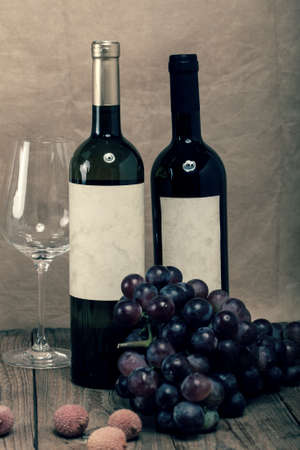 bottle of vine on wooden background photo