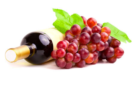 Bottle of red wine with grapes, white background photo