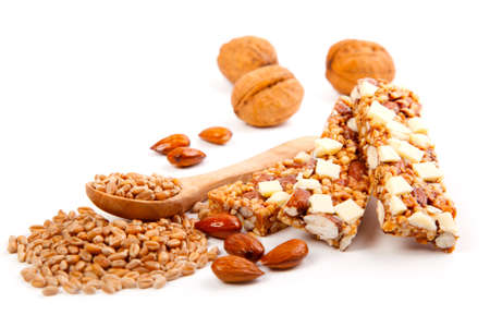 Protein bars with nuts, isolated on white background.  muesli bar snack with nuts and wheat grain photo