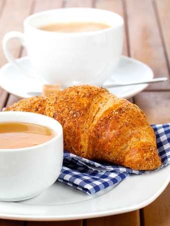 caffee: Croissant with marmalade  and caffee cup. on wooden backgroun