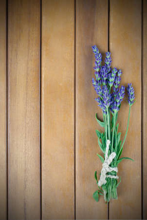 a bunch of lavender flowers on a wooden background photo