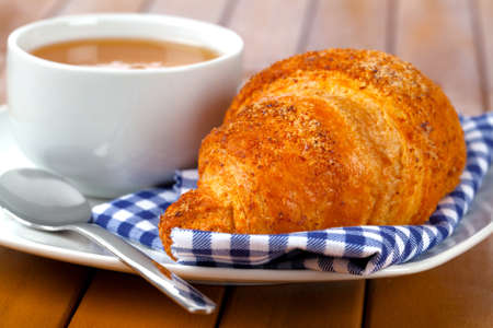 caffee: Croissant with marmalade and caffee cup  on wooden backgroun