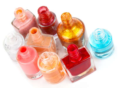 Group of bright nail polishes on white photo