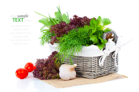 spliced: green herbs in braided basket isolated on white background